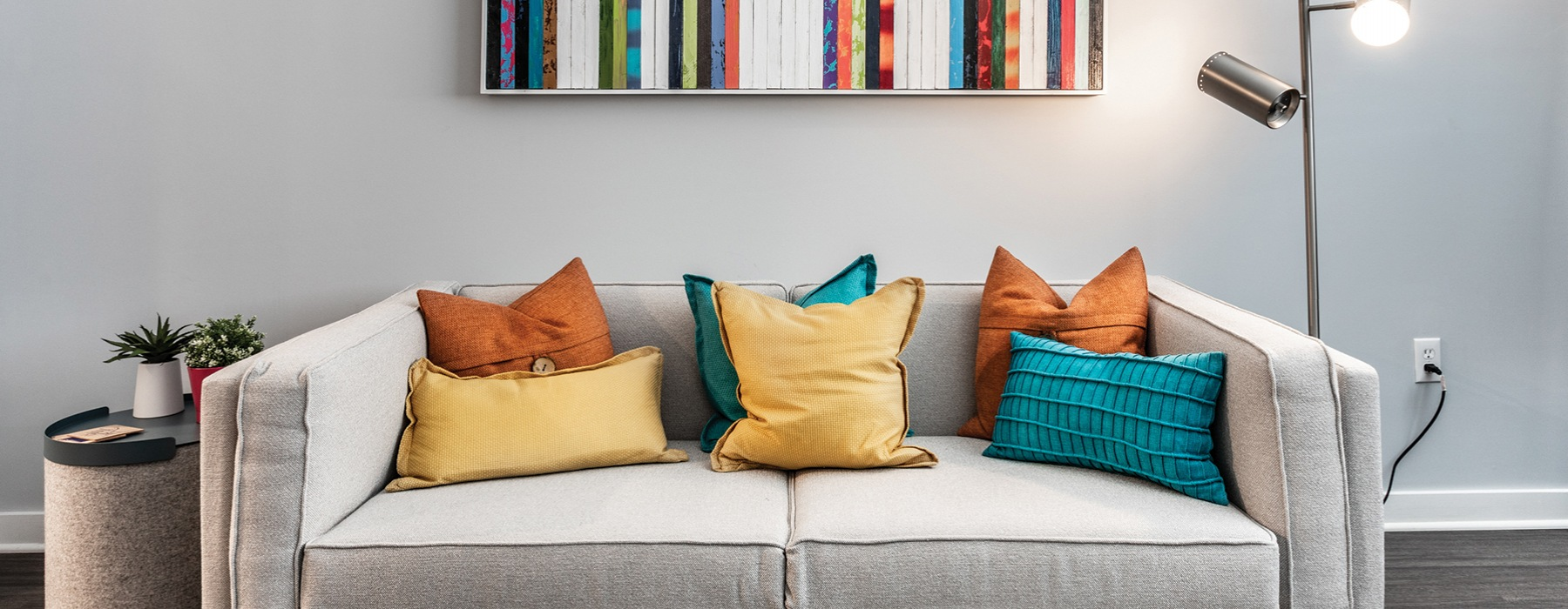 living room with couch and bright colored pillows